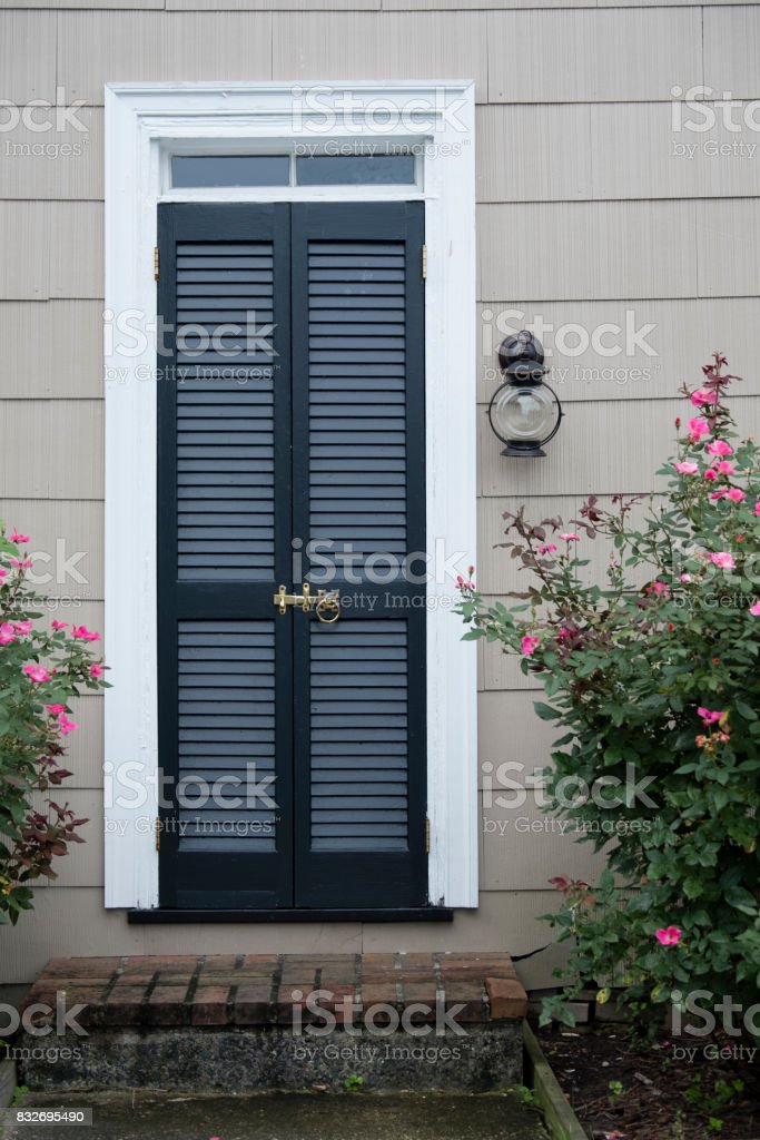 Louvered Blue Door in St. Michael's, Maryland stock photo