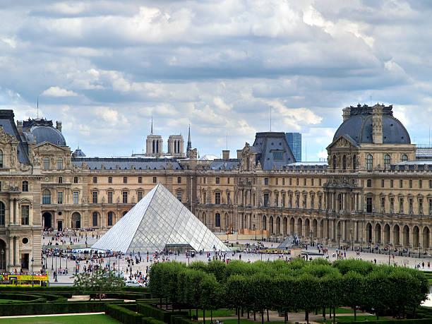 Louvre Museum and Pei's Pyramid. Paris, France. August 11, 2009. musee du louvre stock pictures, royalty-free photos & images
