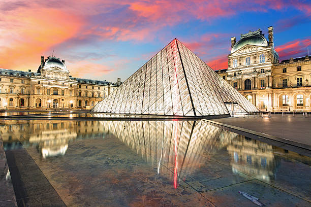 Louvre Museum Paris Paris, France - February 7, 2015: Louvre museum at dusk on February 7, 2015 in Paris. This is one of the most popular tourist destinations in France displayed over 60,000 square meters of exhibition space. musee du louvre stock pictures, royalty-free photos & images