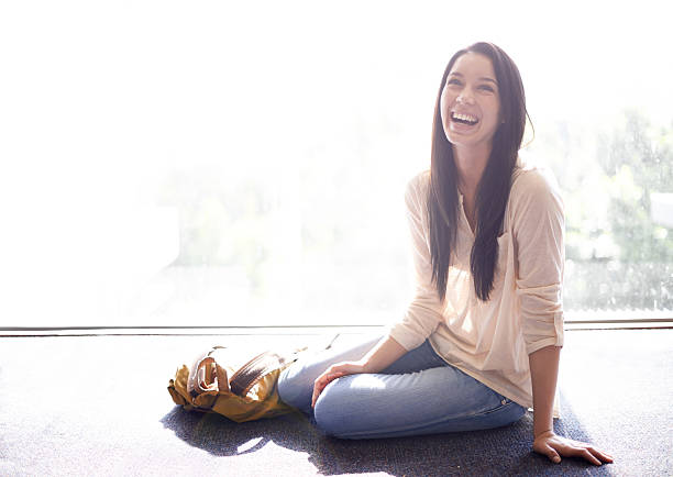 i love a good laugh! - sitting on floor stock photos and pictures