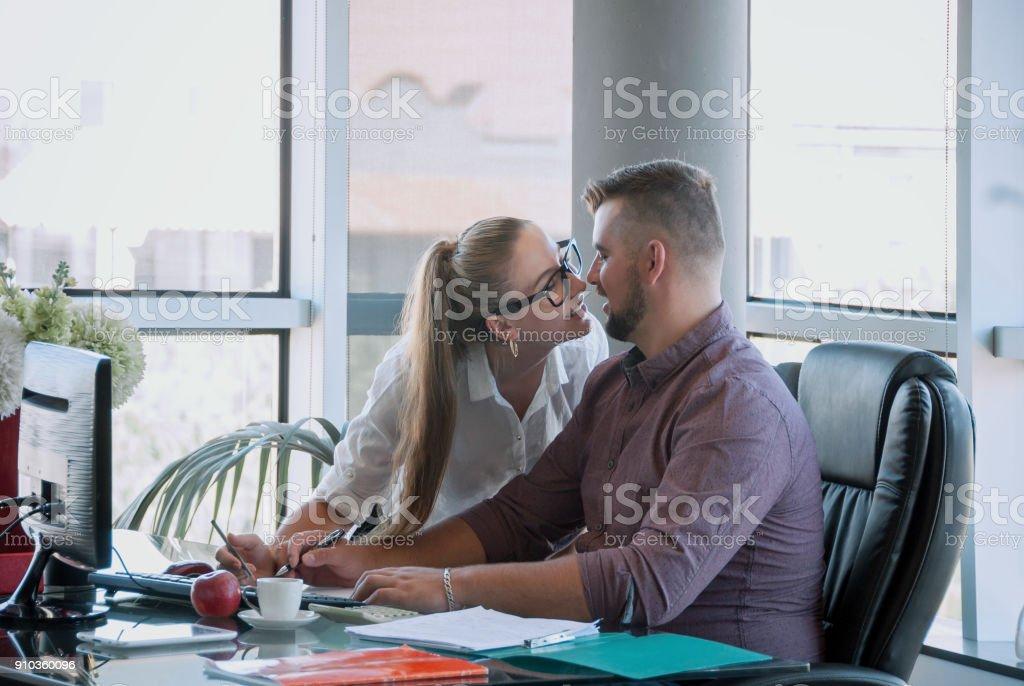 Love affair at work. Secretary kiss her boss. Beautiful girl being in...