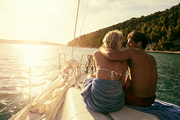 Love anchors the soul Shot of an affectionate couple on a yachthttp://195.154.178.81/DATA/i_collage/pu/shoots/805773.jpg honeymoon stock pictures, royalty-free photos & images