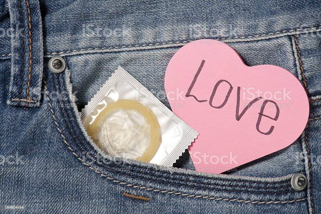 Love and condom in my pocket royalty-free stock photo