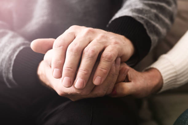Love and support. Elderly people tenderly hold hands Love and support. Elderly people tenderly hold hands, closeup sentimentality stock pictures, royalty-free photos & images