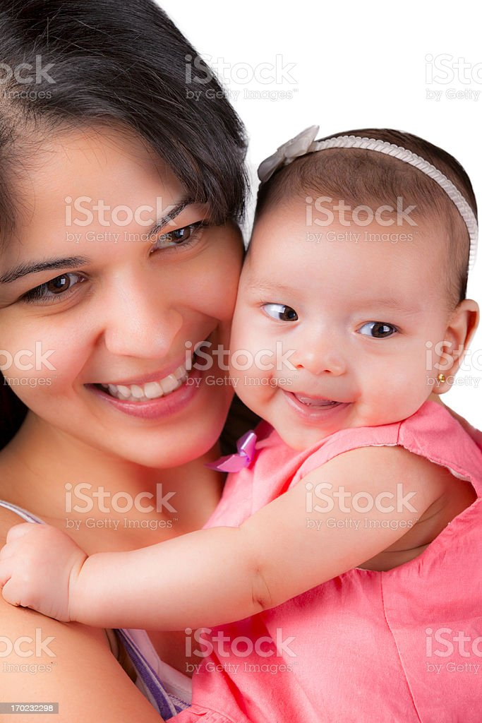 Love and togethernes: Young mother holding baby girl stock photo
