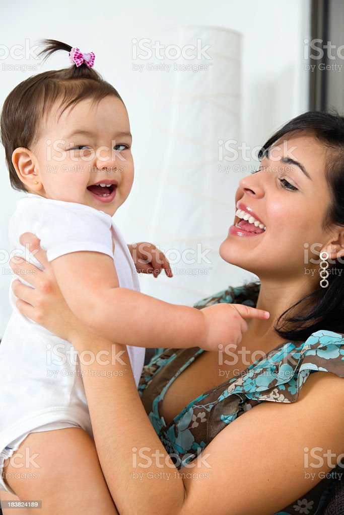 Love and togethernes: young Mother hugging her baby Daugther stock photo