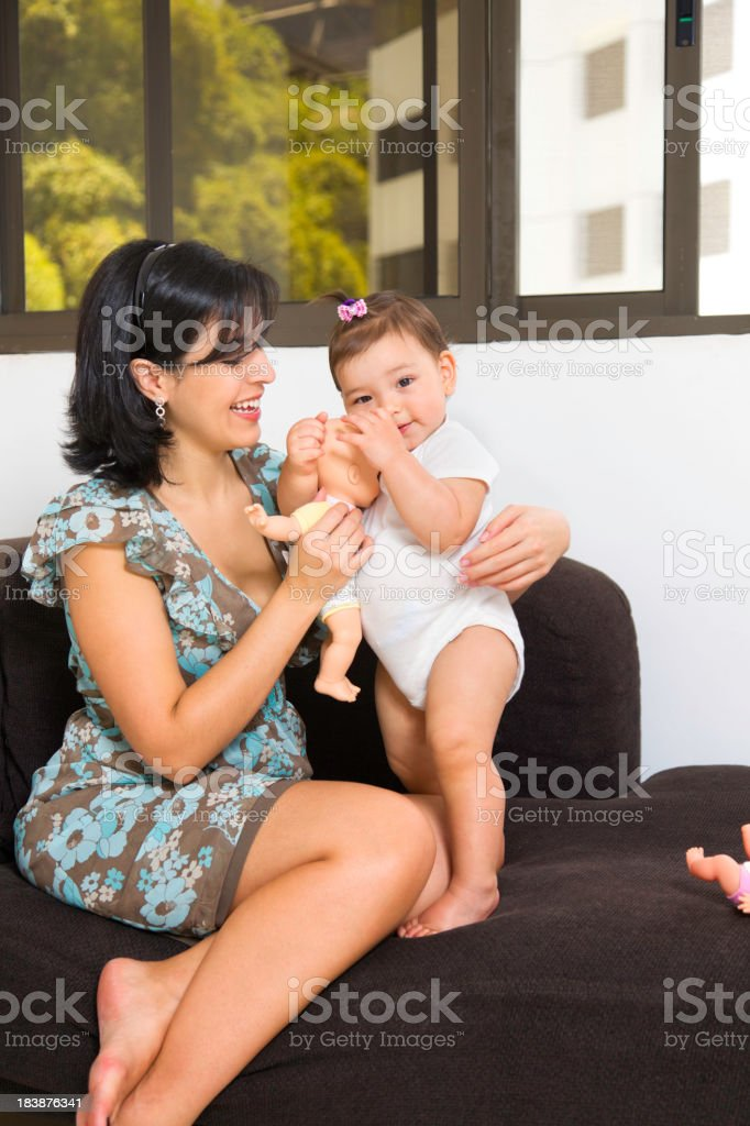Love and togethernes: Young mother playing with baby girl stock photo