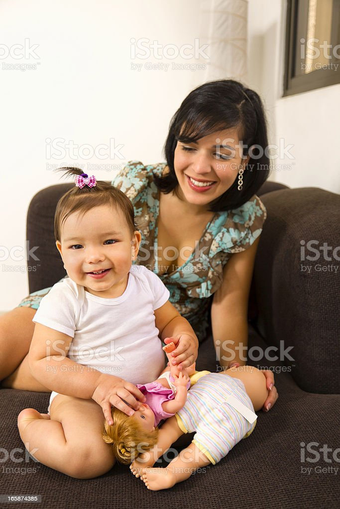 Love and togethernes: Young mother with baby on a couch stock photo