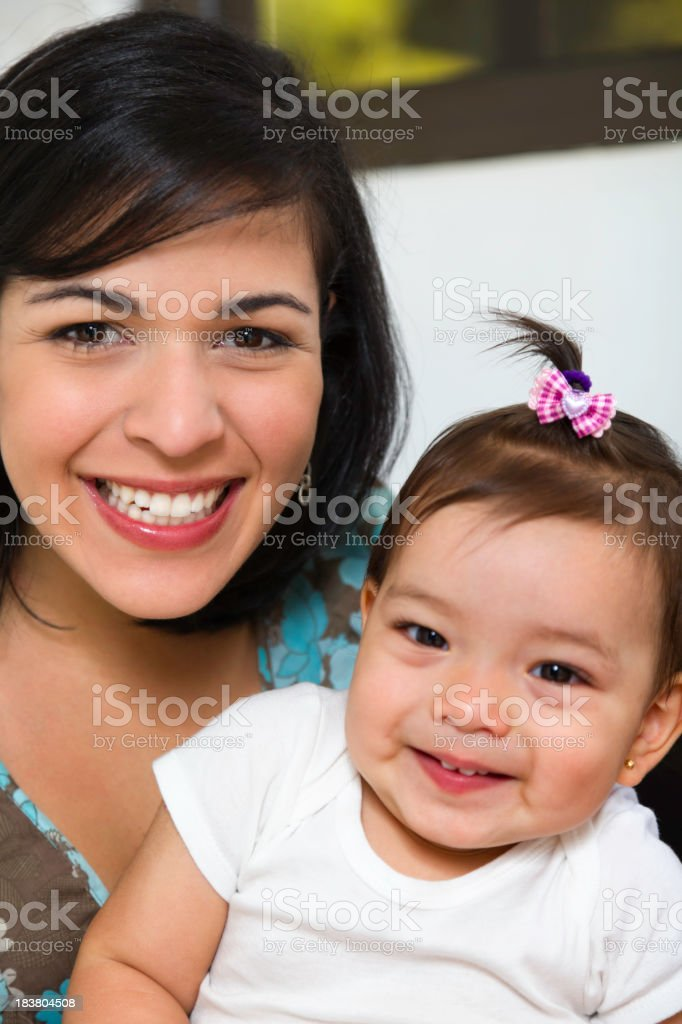 Love and togethernes: Young mother with baby sitting on lap stock photo