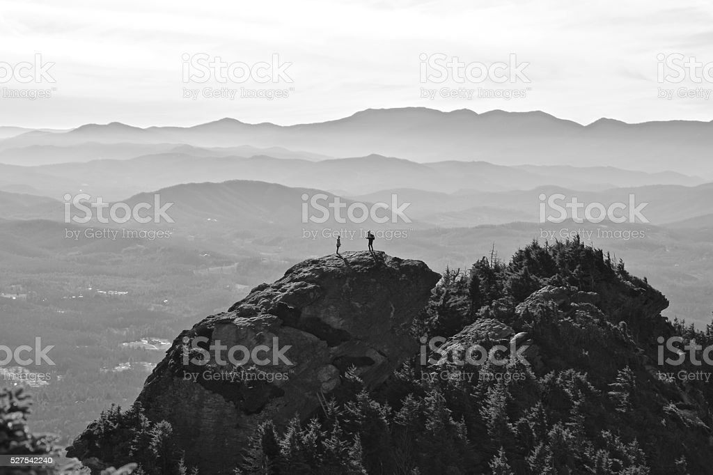 Love atop a mountain in black and white stock photo