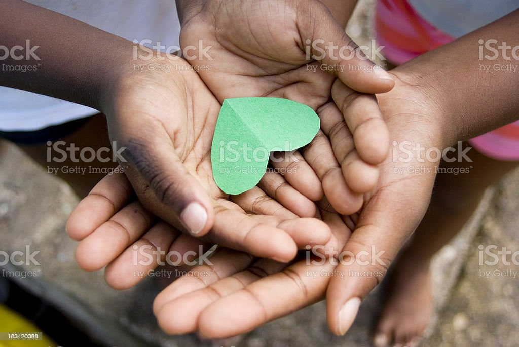 love; beautiful hands of children and precious moments together stock photo