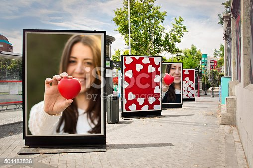istock Love billboards, photographs of a woman with red heart 504483836