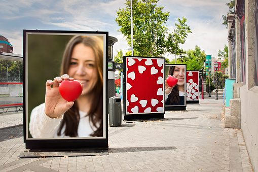 Love Billboards Photographs Of A Woman With Red Heart Stock Photo - Download Image Now