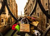 Some love padlocks on a bridge in Venice
