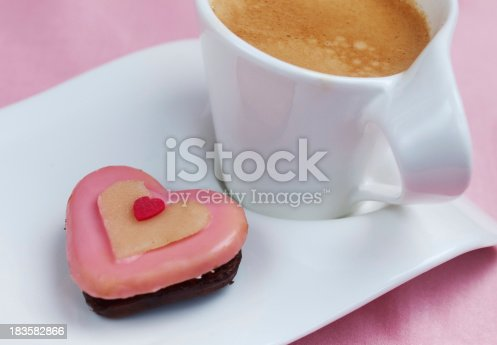 Sweet tasty cake in heart shape with espresso