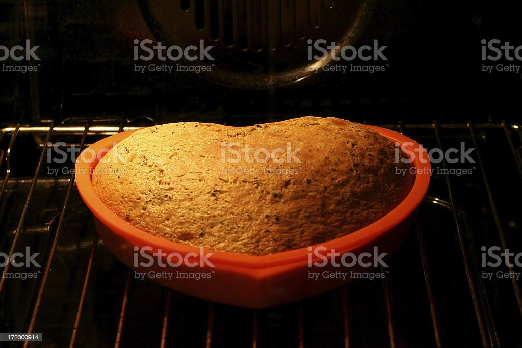 Love cake rising in the oven (5) royalty-free stock photo