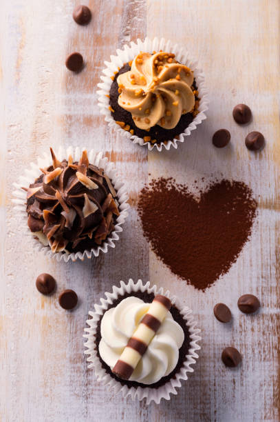 Love chocolate cupcake concept with various cream and decorations stock photo