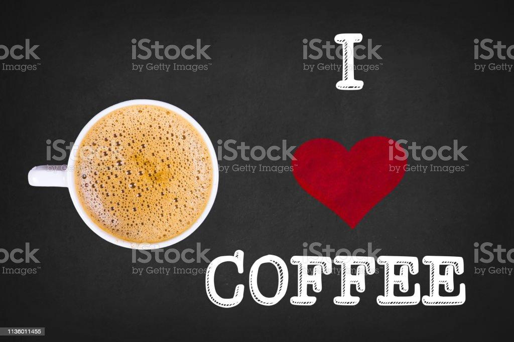 I Love Coffee Text On Blackboard With Coffee Mug