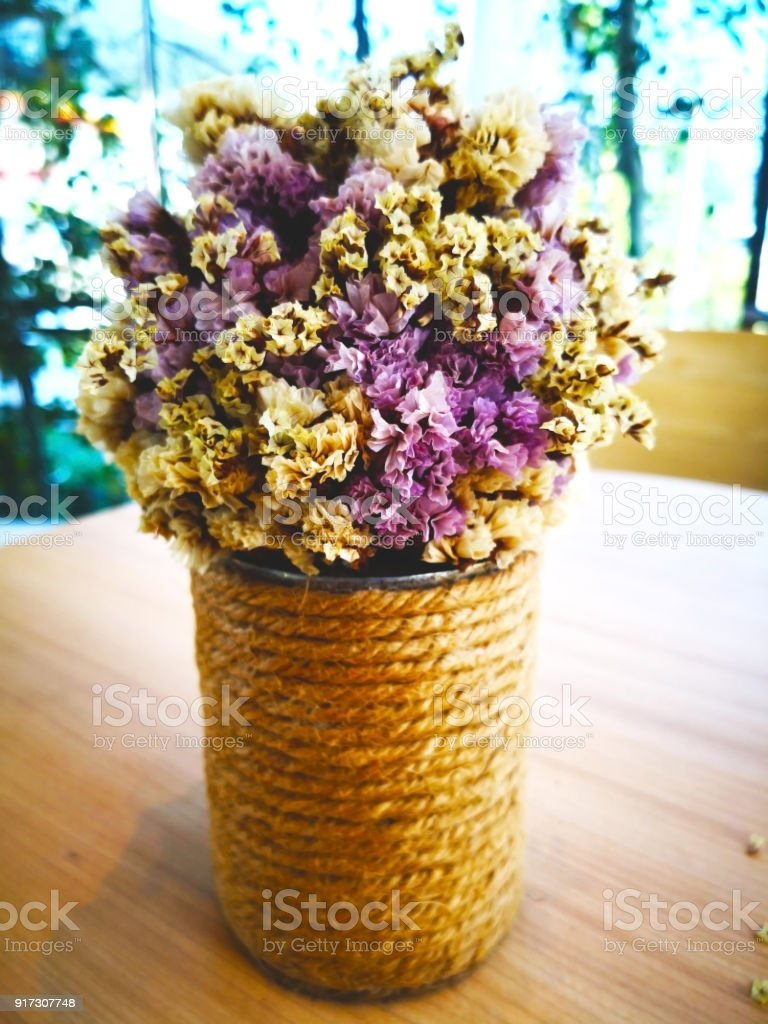 Love concept dry purple flowers and white flowers are arranged in a dry purple flowers and white flowers are arranged in a vase wrapped in izmirmasajfo