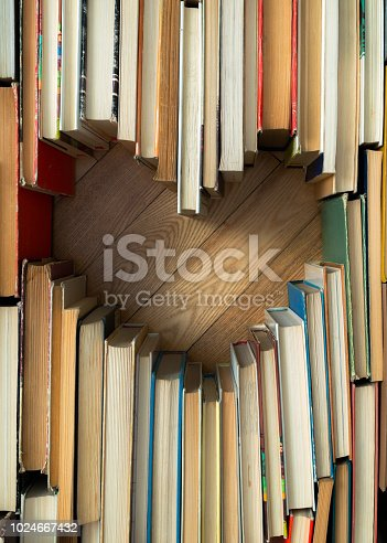 istock Love concept of heart shape from old vintage books on wooden floor background. Vintage color tone style composition of love with open book heart shape 1024667432