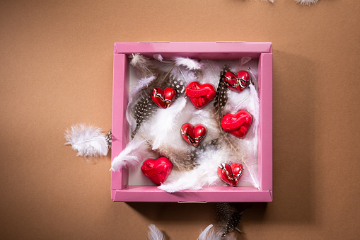 Love concept. Overhead view of Valentines day candies in gift box
