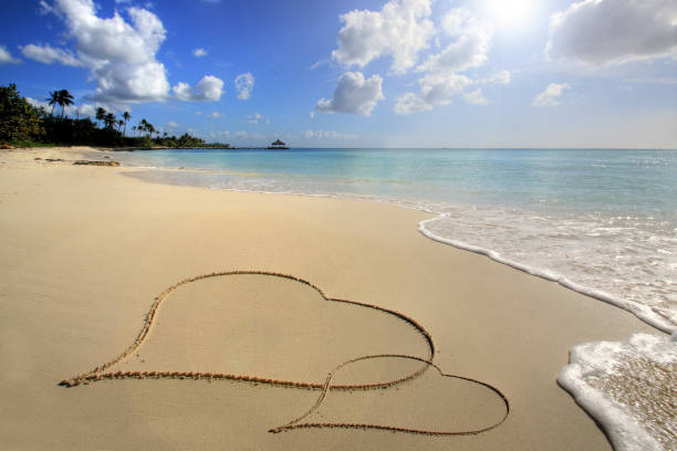 Love concept In the Carribean, Two hearts on sand honeymoon stock pictures, royalty-free photos & images