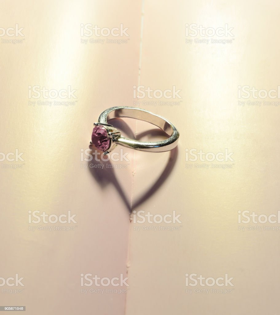 Love concept with a heart shadow of a ring stock photo