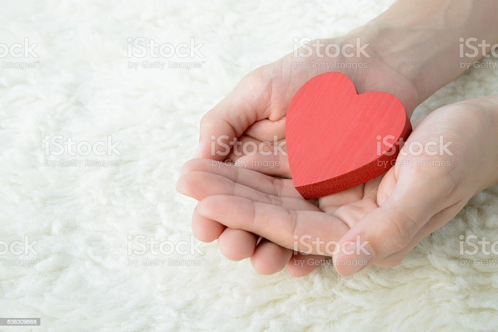 Love concepts, heart in hands stock photo