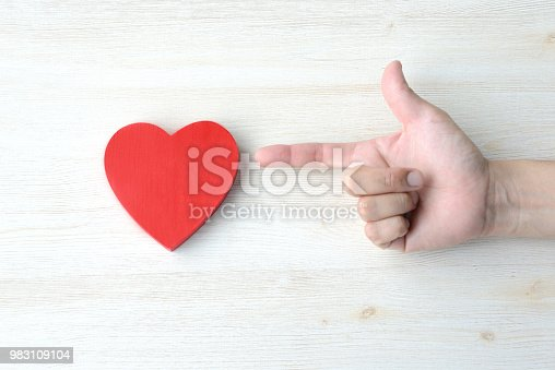 1125634038 istock photo Love concepts, sniping at your heart 983109104