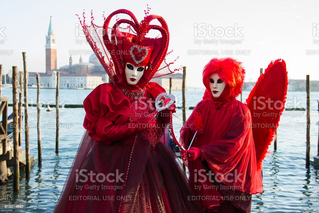 Love costume - Heart - Couple in Venetian Masks - Venice Carnival with Gondolas stock photo
