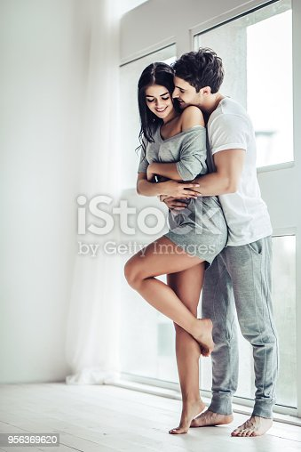 956369394 istock photo Love couple at home 956369620