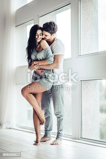 956369394 istock photo Love couple at home 956369622