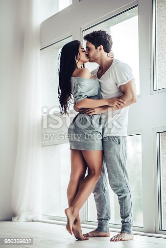 956369394 istock photo Love couple at home 956369632