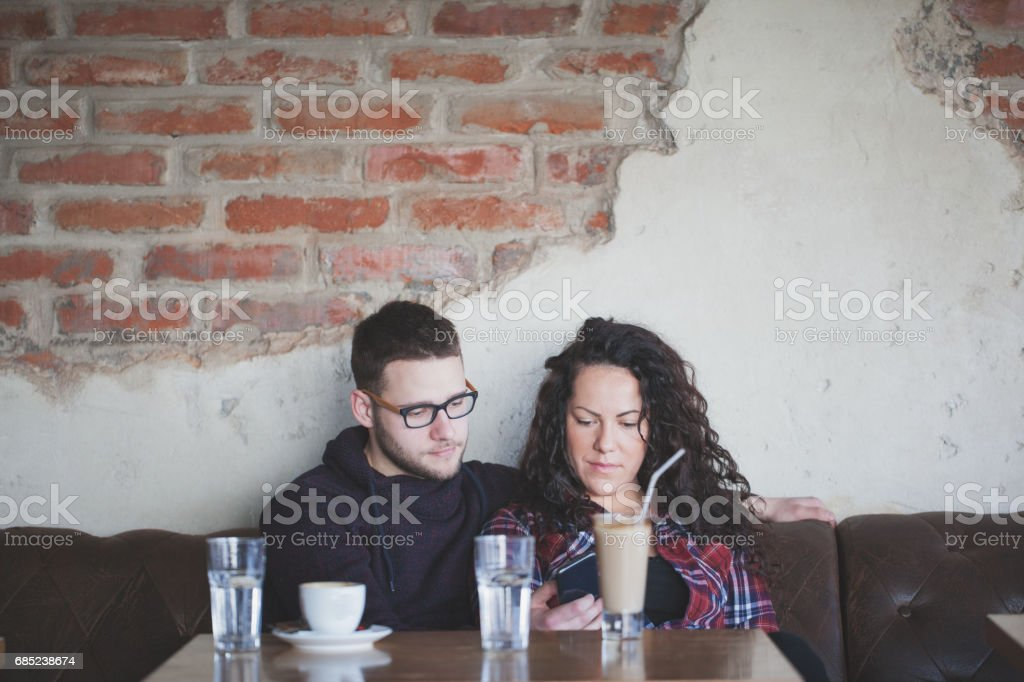 Love couple drinking coffee in cafe bar royalty-free stock photo