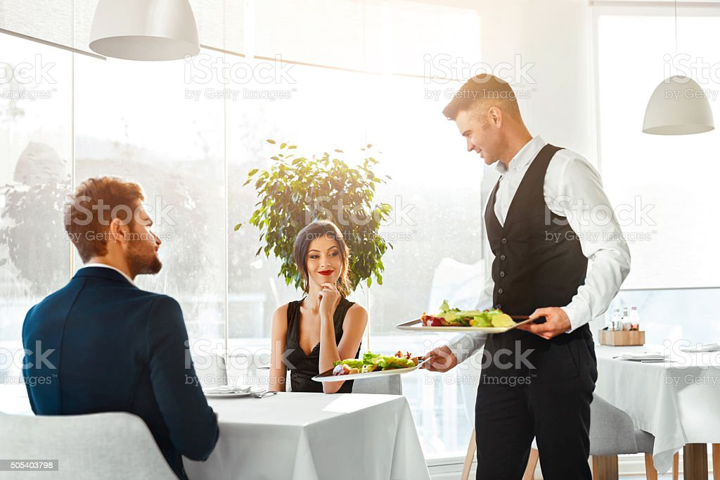 Love Couple Having Romantic Dinner In Restaurant. Healthy Food Eating. stock photo