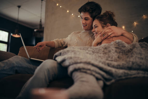 love couple in hygge house with laptop - hygge imagens e fotografias de stock