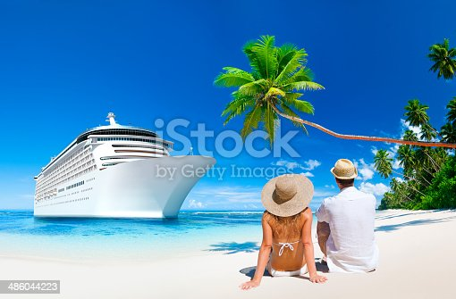 istock Love Couple sitting at the beach 486044223