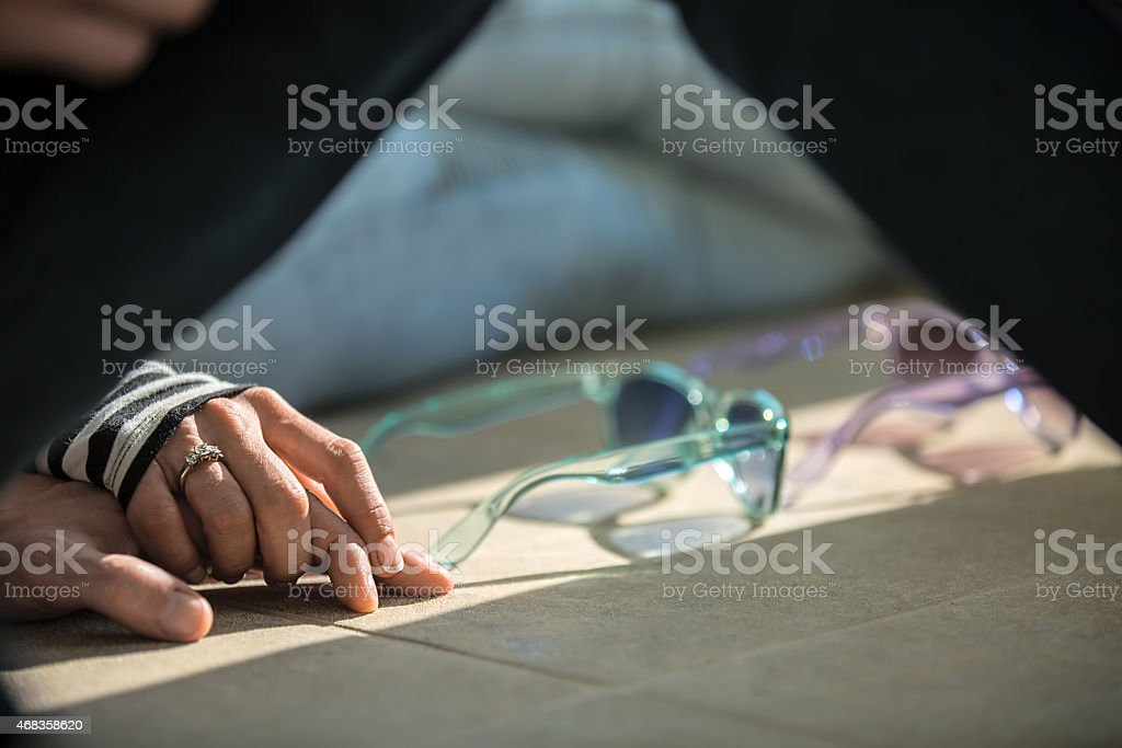 Love couple sitting on the floor holding hands royalty-free stock photo