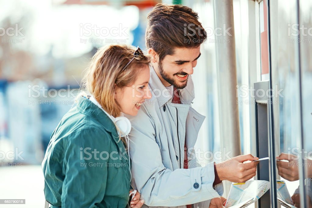 Love Couple Using ATM stock photo