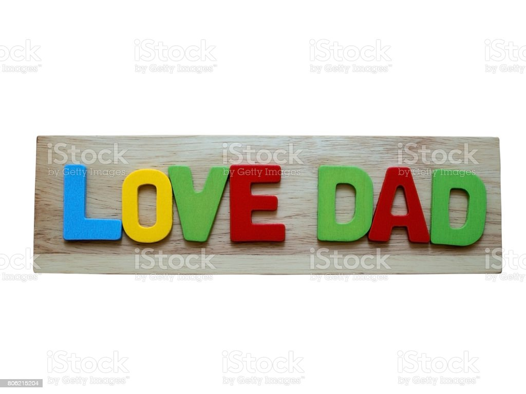 Love dad. Happy Father's Day celebrations. Love dad word from colorful of wood on wooden background isolate on white background. Father's day. stock photo