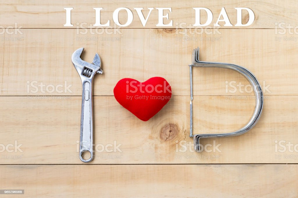 I love dad message on wooden background with red heart and steel tool royalty-free stock photo