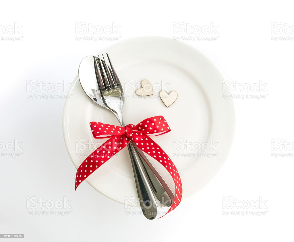 love dinner setting fork and spoon tie with red ribbon stock photo