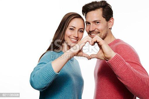 istock Love dovey couple making heart shape, portrait 621135008