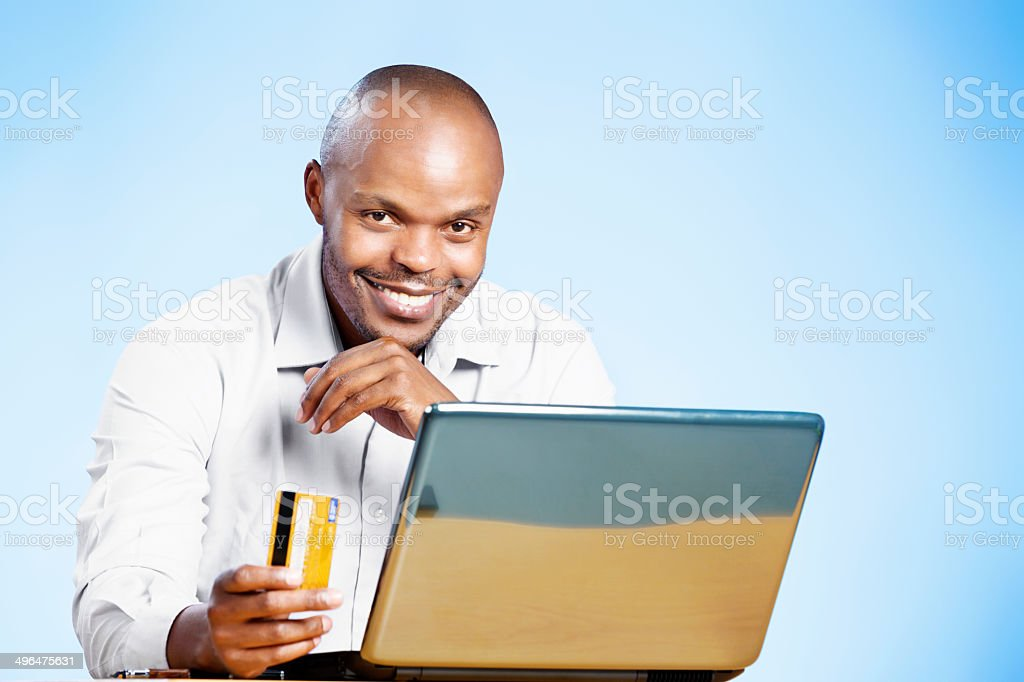 I love e-commerce! Happy man with laptop and credit card stock photo