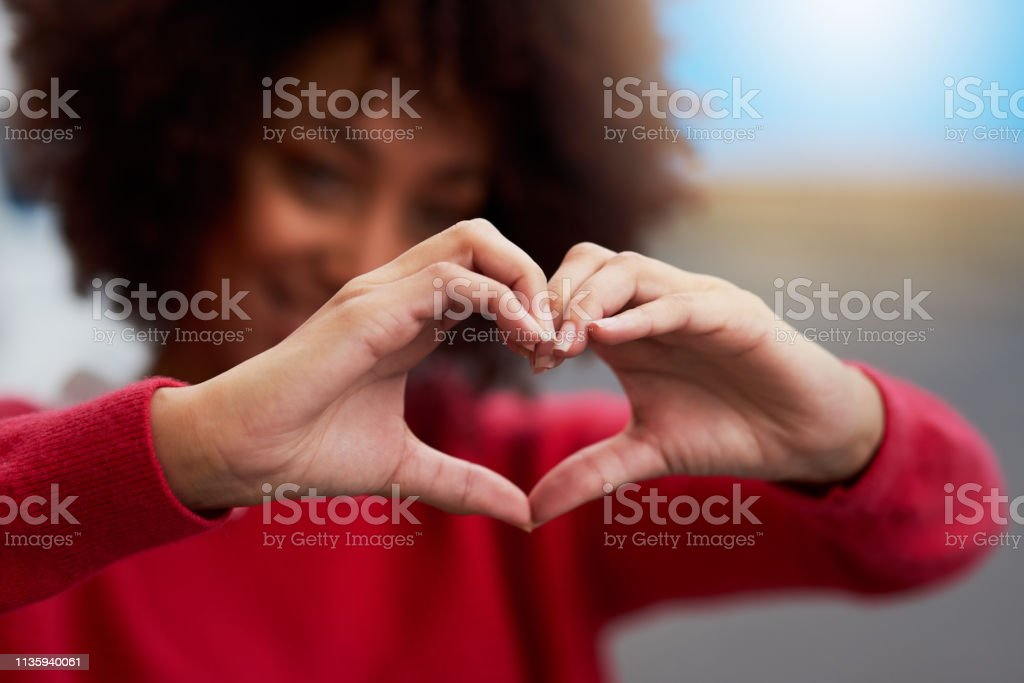 Love everything Cropped shot of an unrecognizable woman forming a heart shape with her fingers 20-29 Years Stock Photo
