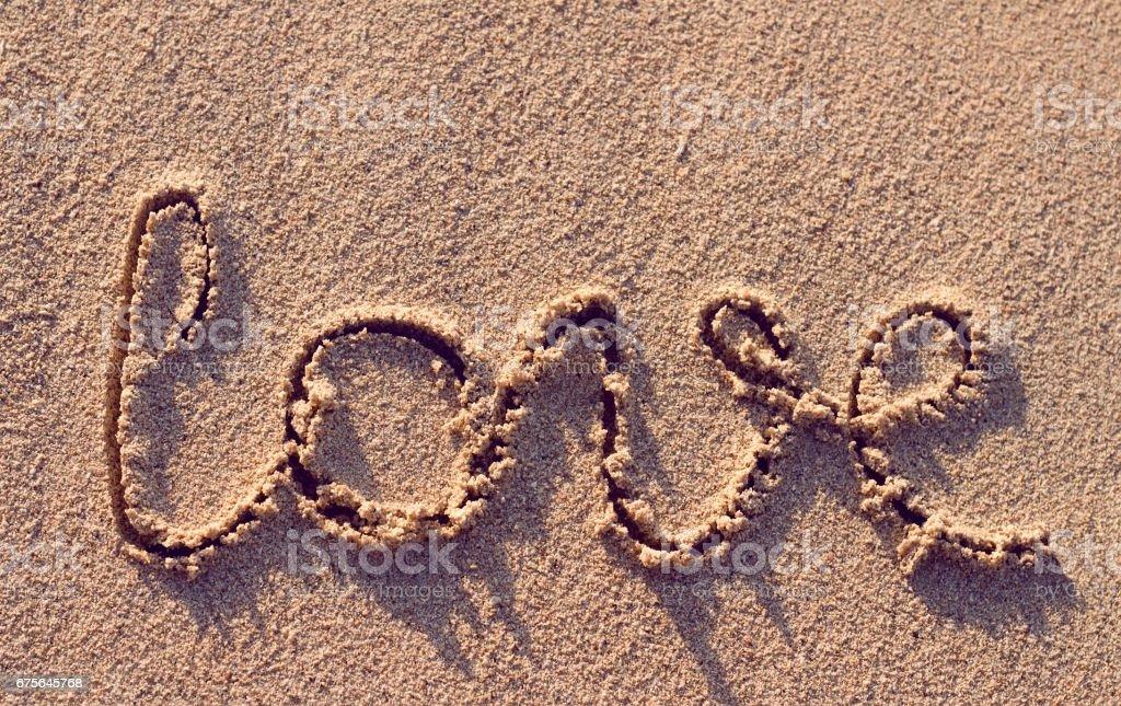 Love handwritten on the tropical beach royalty-free stock photo