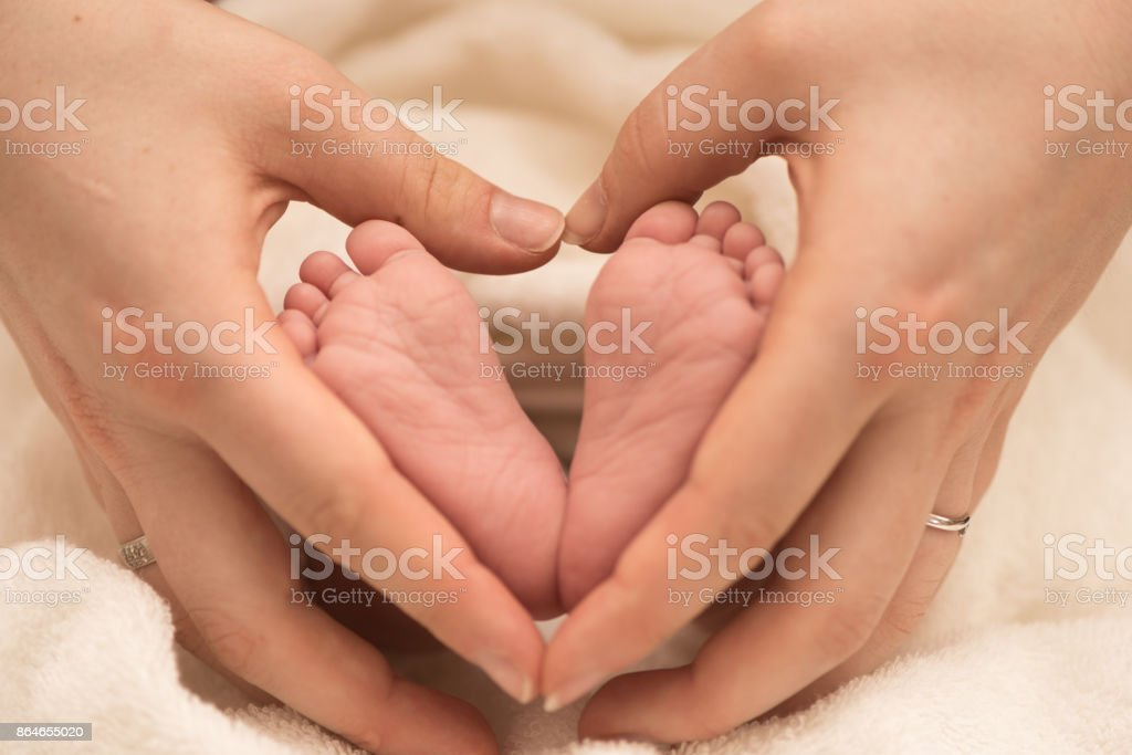 Love - heart around baby leg - infant 2 weeks old stock photo