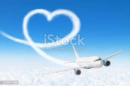 istock Love heart cloud drawing by airplane. Love concept for traveling the world. 1073041066