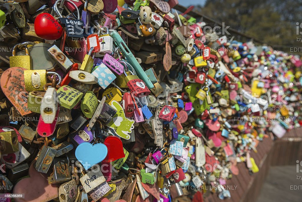 Love heart padlocks chained to fence N Seoul Tower Korea stock photo
