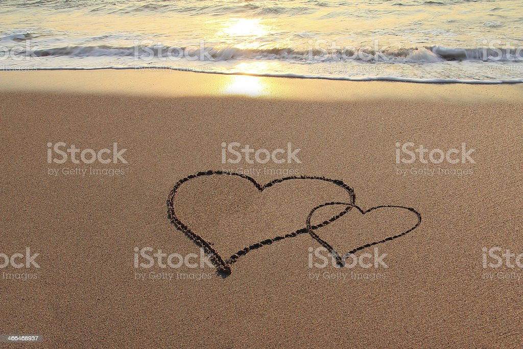 Love Hearts on the beach stock photo